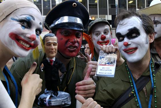 Larry Bogad (red face, center) protests as part of the Clandestine Insurgent Rebel Clown Army