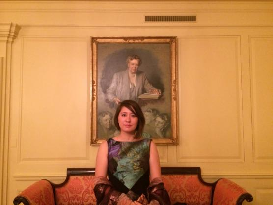 Leah Huntsinger (Design '04) sitting under a portrait of Eleanor Roosevelt in the White House.