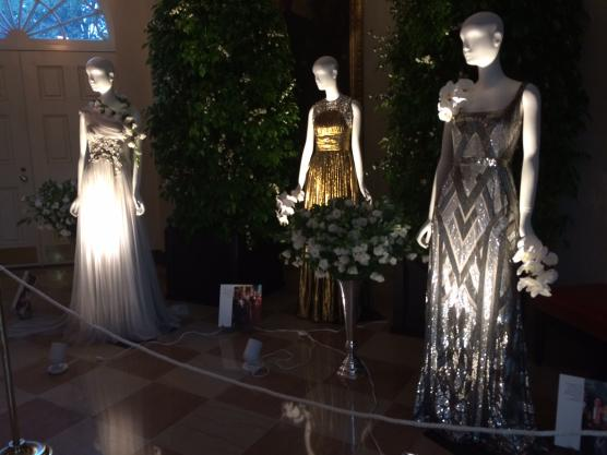 Designer gowns on display in the White House worn by Michelle Obama at various state functions.